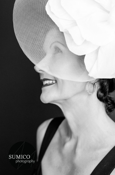 Lady with a white fascinator by Sumico Photography